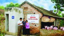 Vietnamese farmers with methane digester