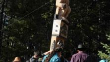 Totem pole being erected.