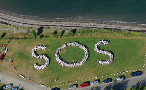"Human formation of ""SOS"" on beach"