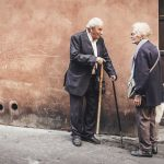Elderly man and woman in lively discussion